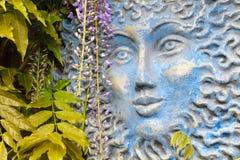 Big blue sun face Stock Photo
