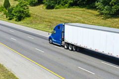 Big blue and white truck. Travelling along the highway Royalty Free Stock Photography