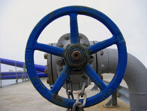 Big blue valve. At the docks stock photo