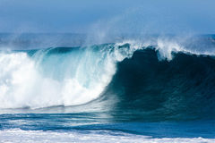 Big blue wave. Large wave breaking at the beach during a swell in Southern California Stock Photo