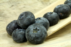 Big blueberries on wood Royalty Free Stock Photos
