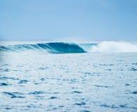 Big Blure Ocean Wave. Blue Ocean Wave breaking in splashes Royalty Free Stock Image