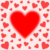 Big blurred heart centered edged with hearts Stock Photography