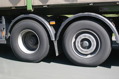 Big blurred lorry wheels on the move. Seen on a german Autobahn stock photos