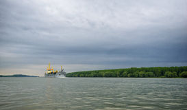 Big boat on Danube river near Galati and dark sky Stock Photos