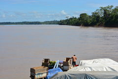Big boat sailing on the Amazon river, Peru. Boat transporting passengers and goods sailing on the big Amazon river, in Peru stock photo