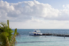 Big boat waiting at the pier on the Caribbean ocean shore stock images