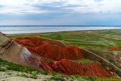 Big Bogdo mountain. Red sandstone outcrops on the slopes sacred mountain in Caspian steppe Bogdo - Baskunchak nature reserve, royalty free stock photography