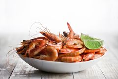 Big boiled shrimps in white plate royalty free stock images