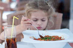 Big bolognese plate. Big portion of spagetti for a little girl Stock Image