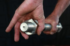Big Bolt and Nut. Big steel bolt and nut held by a man's hand Royalty Free Stock Images