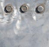 Big bolts. Metal plate and big bolts royalty free stock image