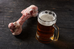 Big bone and beer on a table Royalty Free Stock Photo