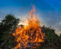 Big bonfire against blue sky stock images