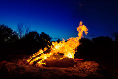 Big bonfire against night sky in Australian outback Royalty Free Stock Images