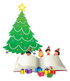 Big book and children by christmas tree Royalty Free Stock Images