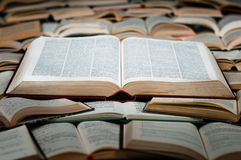 Big book on heap of books Royalty Free Stock Images