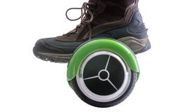 Big boot riding a hover board Stock Photography