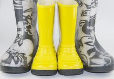 Big boots, little boots Stock Photography