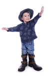 Big boots for little boy Royalty Free Stock Images