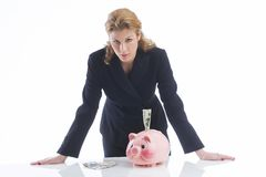 Big boss. Business lady at work with a piggy bank with one hundred dollar Stock Photos