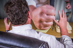Big Boss Fist Slamming Down on Male Worker Desk - Work Stress Pr. Essure Series Stock Photo