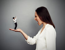 Big boss screaming at the subordinate. Concept photo of big boss screaming at the small subordinate Stock Photo