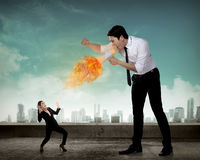 Big boss yelling to her employee with megaphone on fire Stock Photos