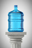 Big bottle of water over Stone Classic Greek Column Royalty Free Stock Photos