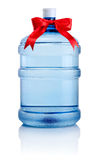 Big bottle of water tied with a red ribbon bow Isolated Stock Photography