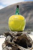 Big bottles with grape wine - malvasia.  Lanzarote. Spain Royalty Free Stock Image