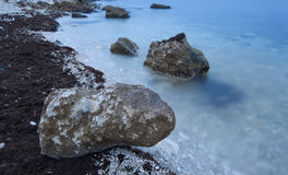 Big boulder on the bank of the  blue sea Stock Image