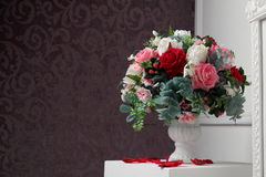 Big bouquet of flowers on the column. A large bouquet of flowers on a column in the lobby Royalty Free Stock Photography