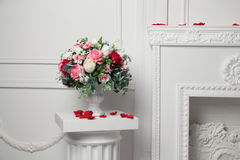 Big bouquet of flowers on the column. A large bouquet of flowers on a column in the lobby Stock Photography