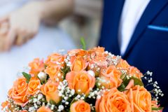 Big flower bouquet. Big Bouquet and Two Wedding Rings. Goods for wedding. This photo is perfect for magazines, shops dealing with wedding dresses ceremonies Stock Photo