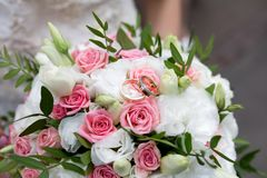 Big flower bouquet. Big Bouquet and Two Wedding Rings. Goods for wedding. This photo is perfect for magazines, shops dealing with wedding dresses ceremonies Stock Images