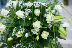 Big bouquet of white roses, yellow daffodils, greenery and lotuses Royalty Free Stock Photo