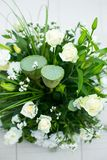 Big bouquet of white roses, yellow daffodils, greenery and lotuses Stock Image