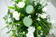 Big bouquet of white roses, yellow daffodils, greenery and lotuses Royalty Free Stock Image