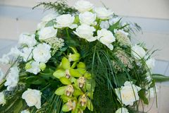 Big bouquet of white roses, yellow daffodils, greenery and lotuses Stock Images