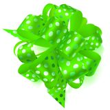 Big bow made of ribbon in polka dots. Beautiful big bow made of green ribbon in polka dots with shadow on white background Royalty Free Stock Photos