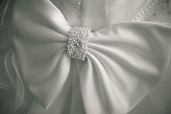 Big bow on a wedding dress. simple background. Royalty Free Stock Images