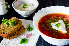 Big bowl of borscht with sour cream and herbs Royalty Free Stock Photography