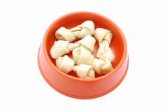 Bowl of dog bones Stock Images
