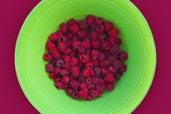 Big bowl of garden fresh Raspberries royalty free stock photos