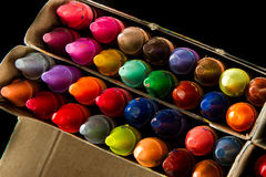 Big box of many crayons Royalty Free Stock Image