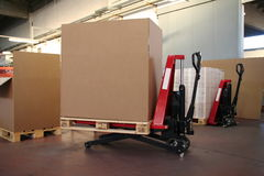 Big boxes on lift. Big carton boxes on fork lifting - Room for your logo or text royalty free stock photo