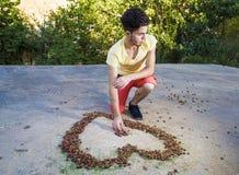 Big boy drawing heart Stock Image