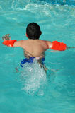 Big boy swimming Stock Images