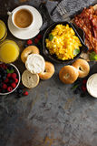 Big breakfast with bacon and scrambled eggs. Big breakfast with bacon, bagels and scrambled eggs on the table overhead with copy space Stock Photography